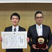 2014-01-17-表彰を受けた佐孝さんと大友さん